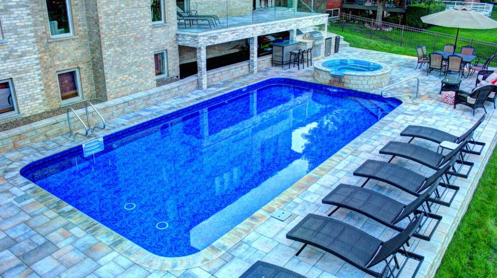 Vinyl Rectangle Pool with Spillover Spa by All Seasons Pools & Spas, Inc.