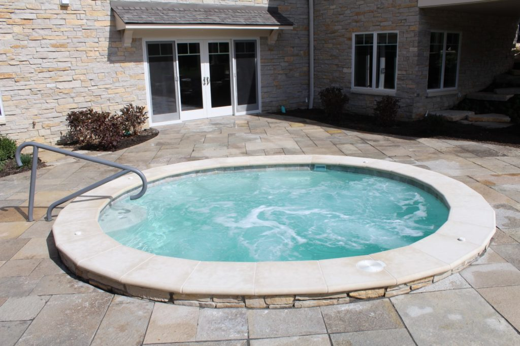 Custom Oval Shotcrete Spa with great features in Orland Park, IL