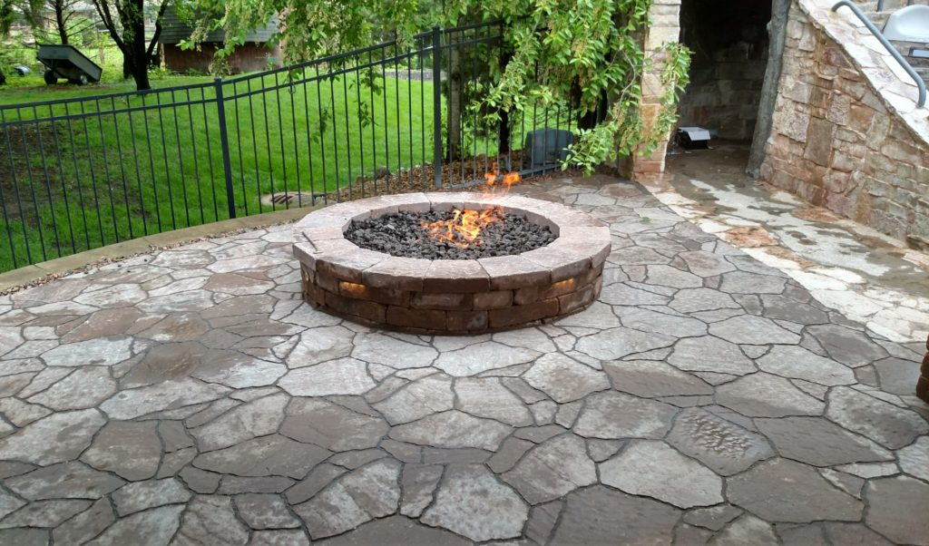 Custom outdoor firepit a project by All Seasons Pools & Spas, Inc.
