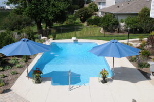 Vinyl Rectangle pool with two blue umbrellas in Orland Park, IL